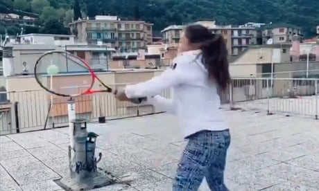 GUARDIAN TENNIS: Pair play tennis between rooftops during coronavirus lockdown in Italy – video
